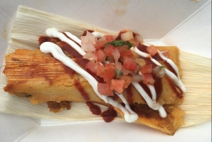 Beef Corn Tamale a la Plancha with spicy rojo sauce